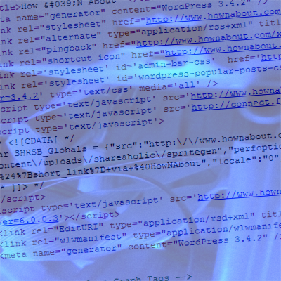 HTML code overlayed onto a photograph of the innards of a computer.