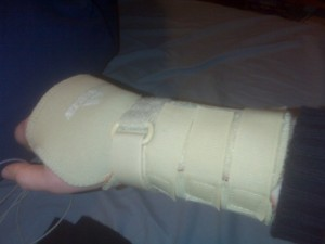 Zoe's right hand and forearm encased in a wrist brace